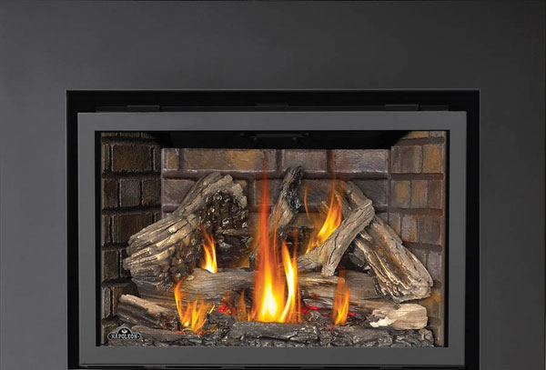 Shown here is the Napoleon XIR3 contemporary fireplace insert.  It utilizes a traditional ceramic log set with optional interior brick patterns, while the clean and minimal surround allows for a timeless look that will go with any room decor.